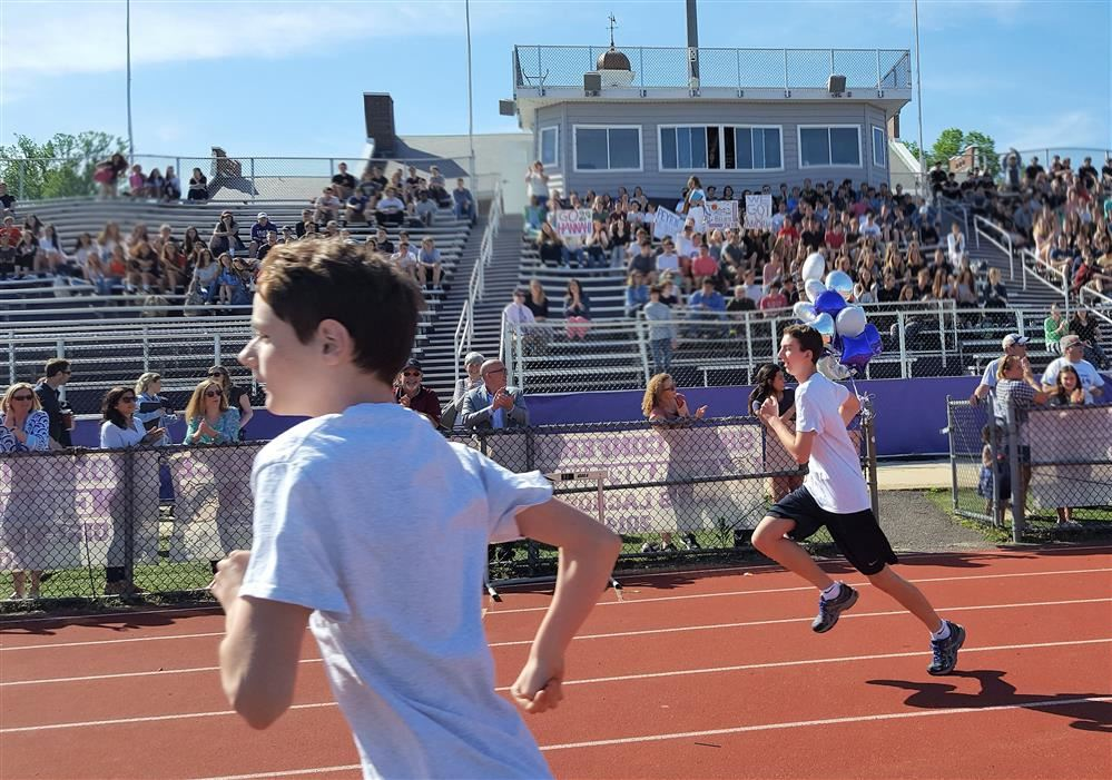 From left, Matt Newman and Tommy Coene begin the 800-meter race at the RFH Tri-District Olympics.